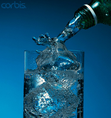 Sparkling Water Splashing On Ice --- Image by © Larry Larimer/Brand X/Corbis